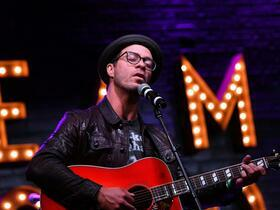 Advertisement - Tickets To Amos Lee