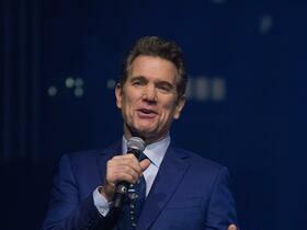 Advertisement - Tickets To Chris Isaak