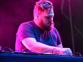 Advertisement - Tickets To Com Truise