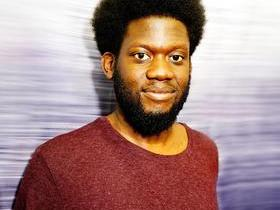 Michael Kiwanuka with Sammy Brue