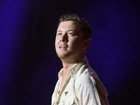 Advertisement - Tickets To Scotty McCreery