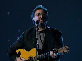 Advertisement - Tickets To Vince Gill